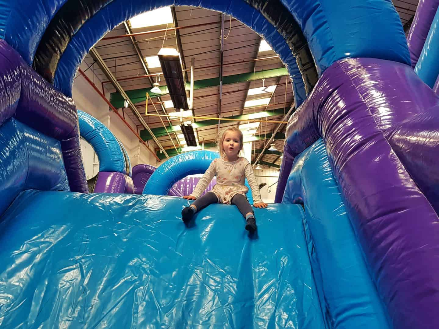 Inflata Nation Birmingham girl on obstacle course slide