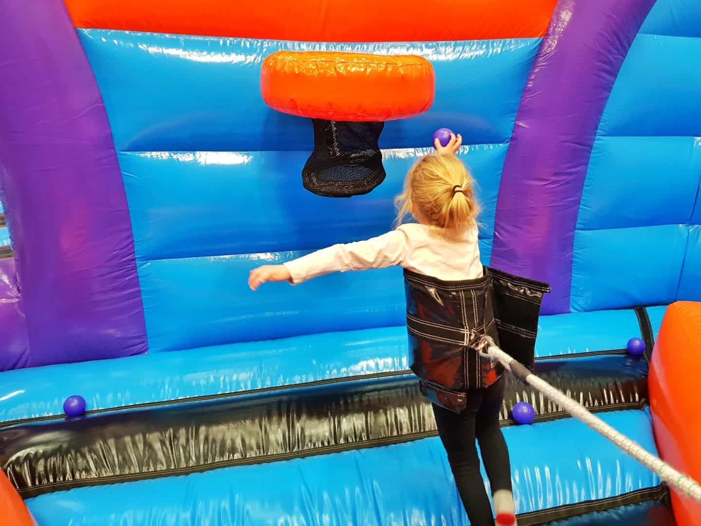 Inflata Nation Birmingham girl on bungee game reaching for basket