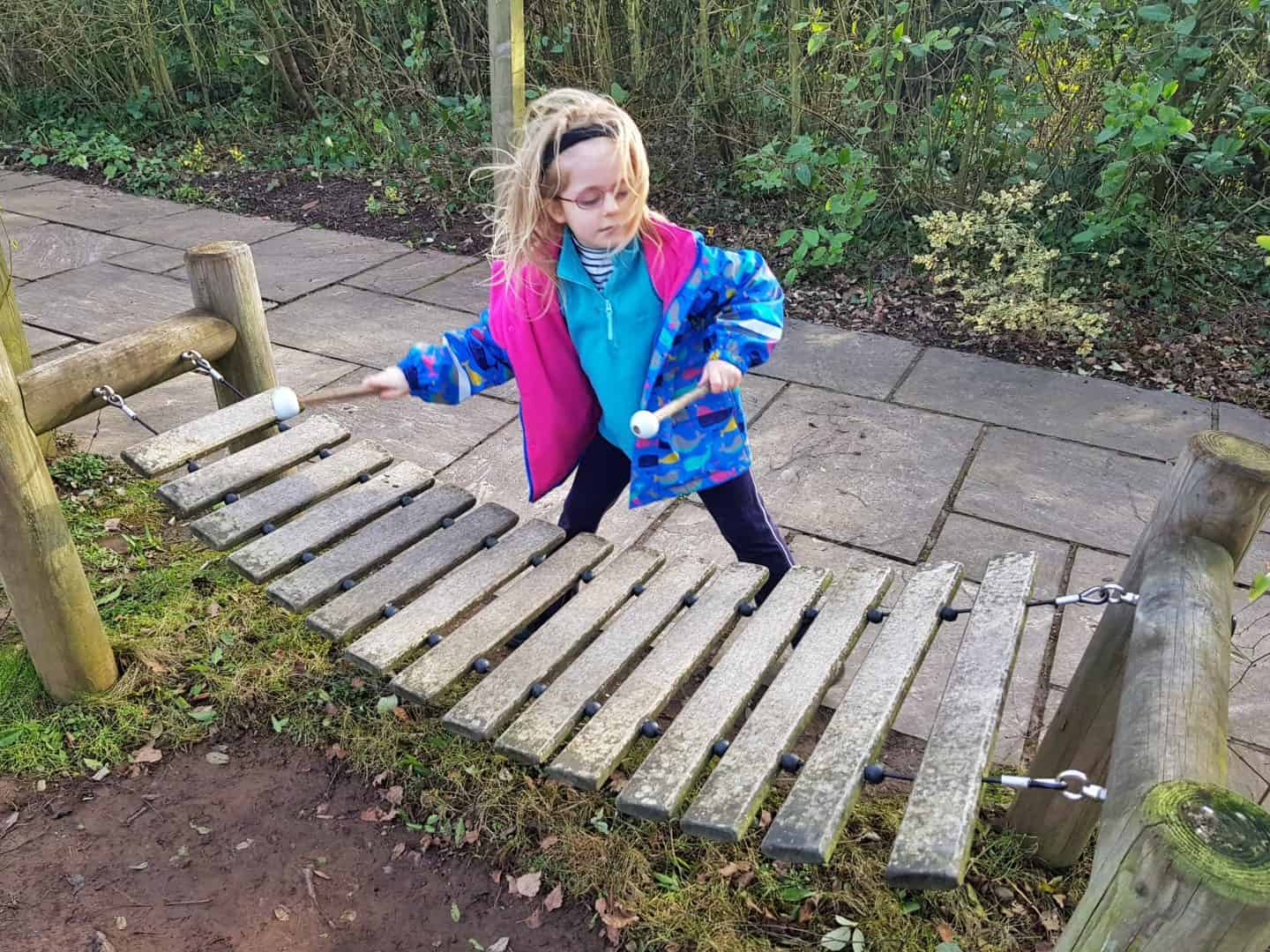 The Firs National Trust in Worcestershire girl playing xylophone