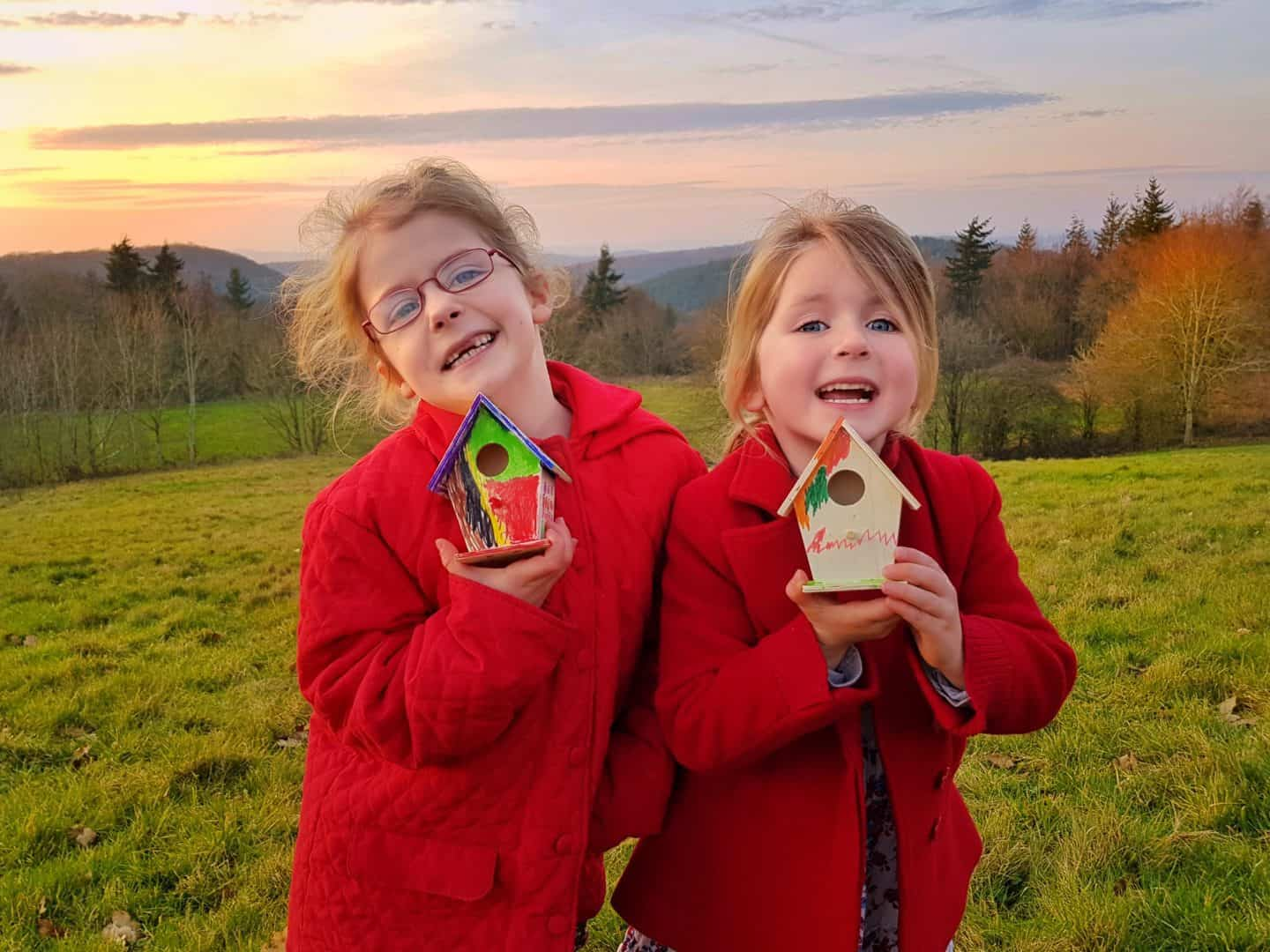 Crowngate Shopping Centre Worcester kids club girls showing bird houses against sunset sky