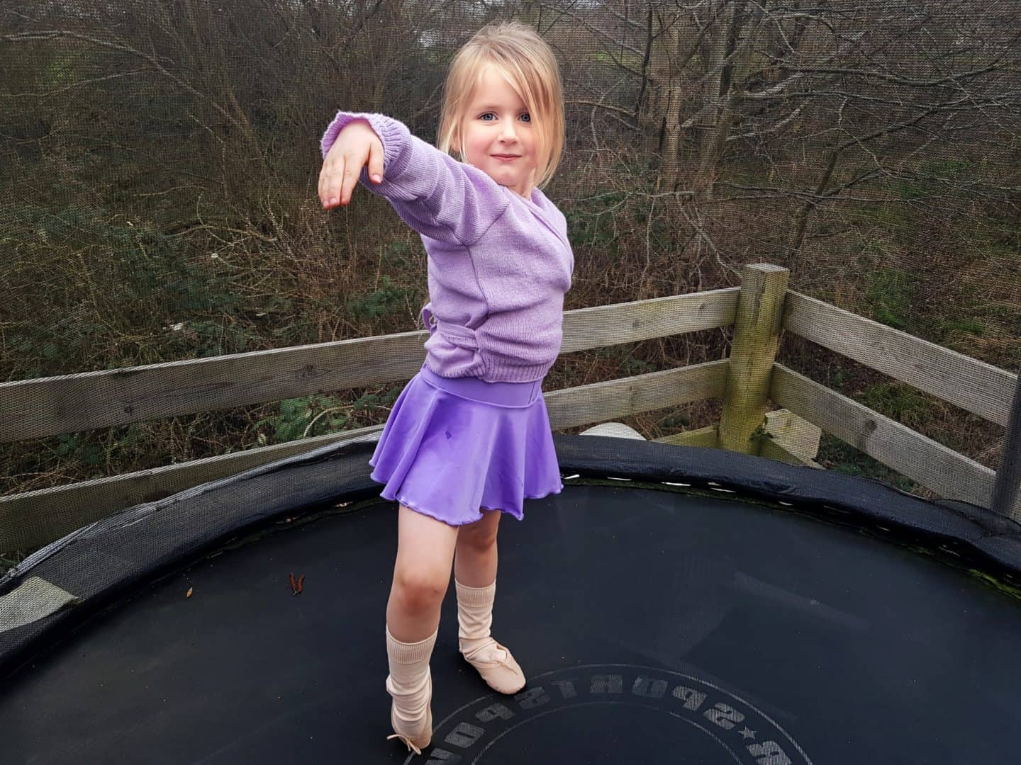 Dance Gear review girl in purple ballet leotard and cardigan
