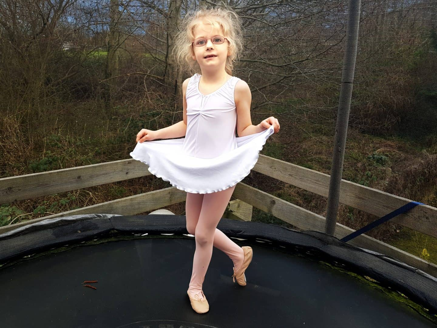 Dance Gear review girl in white ballet leotard curtseying