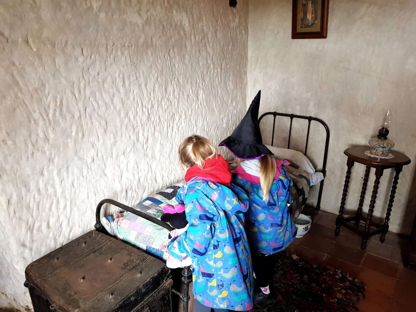 Kinver Edge and the Rock Houses National Trust West Midlands children looking at antique bed