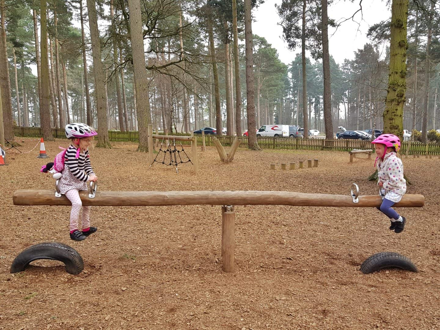 girls on seesaw at park
