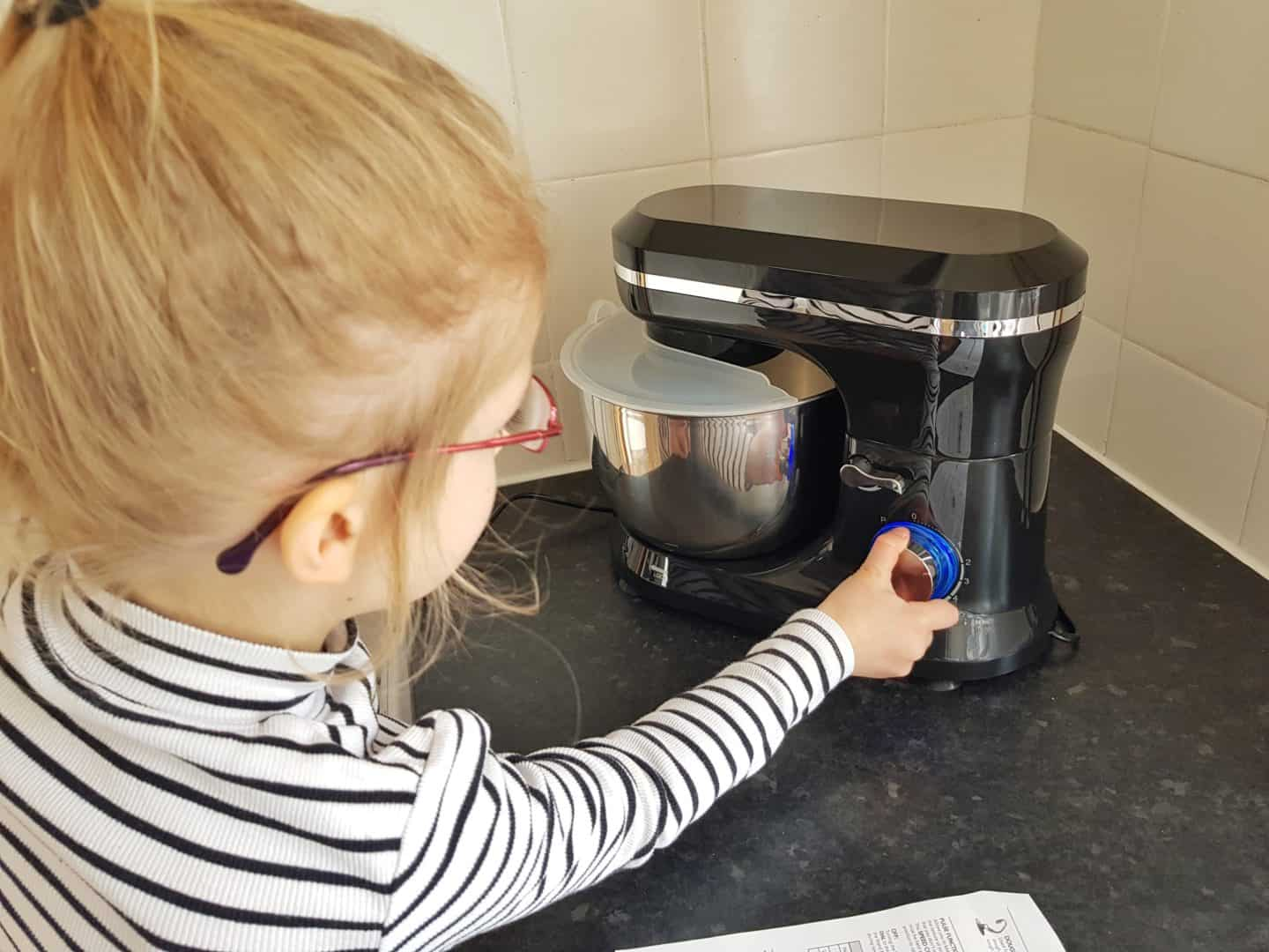 Girl operating Von Shef stand mixer