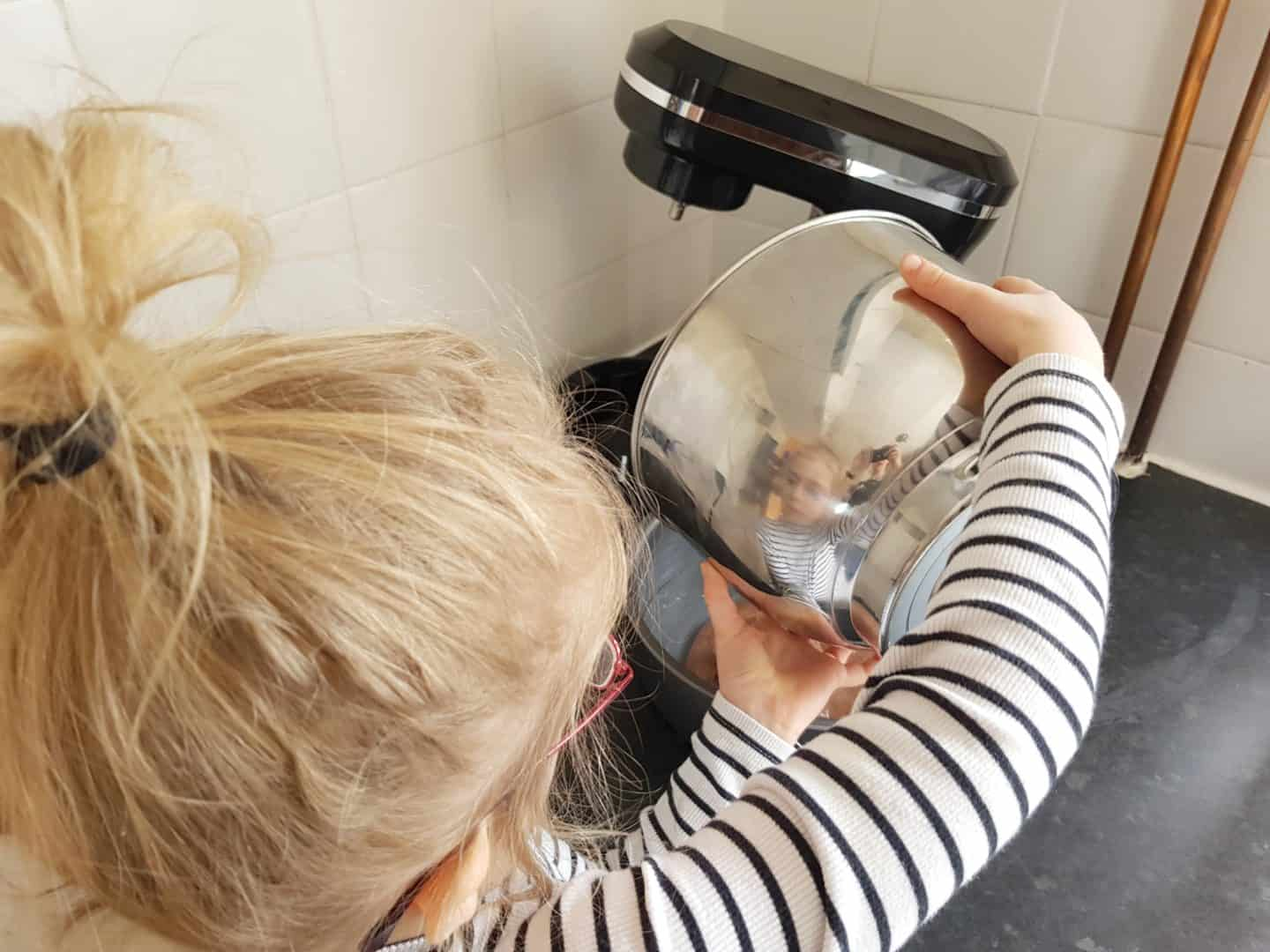 Girl pouring cake mixture from Von Shef stand mixer stainless steel mixing bowl