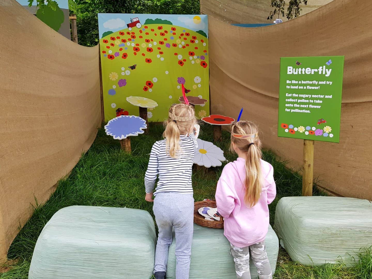 girls playing butterfly game at Lost Gardens of Heligan