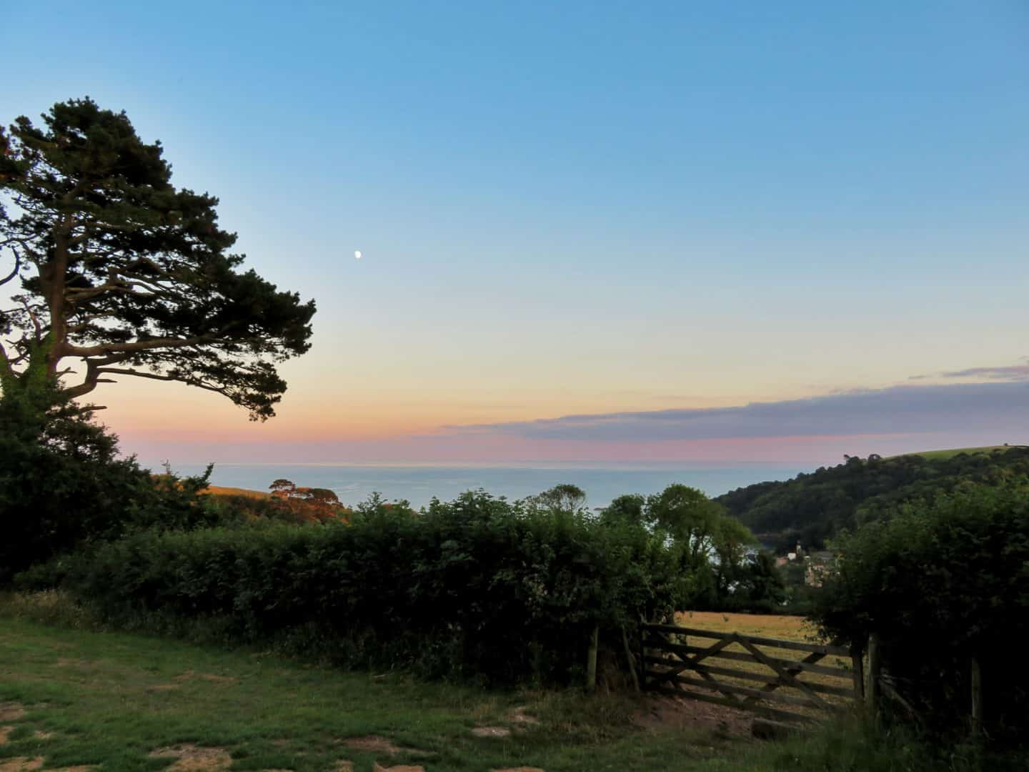 view over coast from Feather Down glamping at sunset