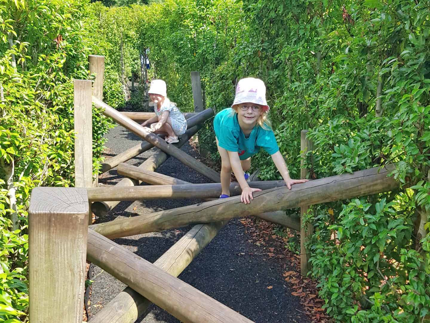 Children climbing on wood in Horrible Histories Maze at Warwick Castle