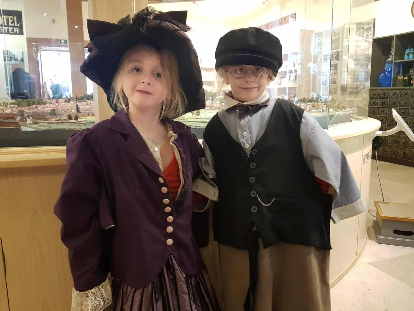 Children dressed in Edwardian outfits at Winchester city museum