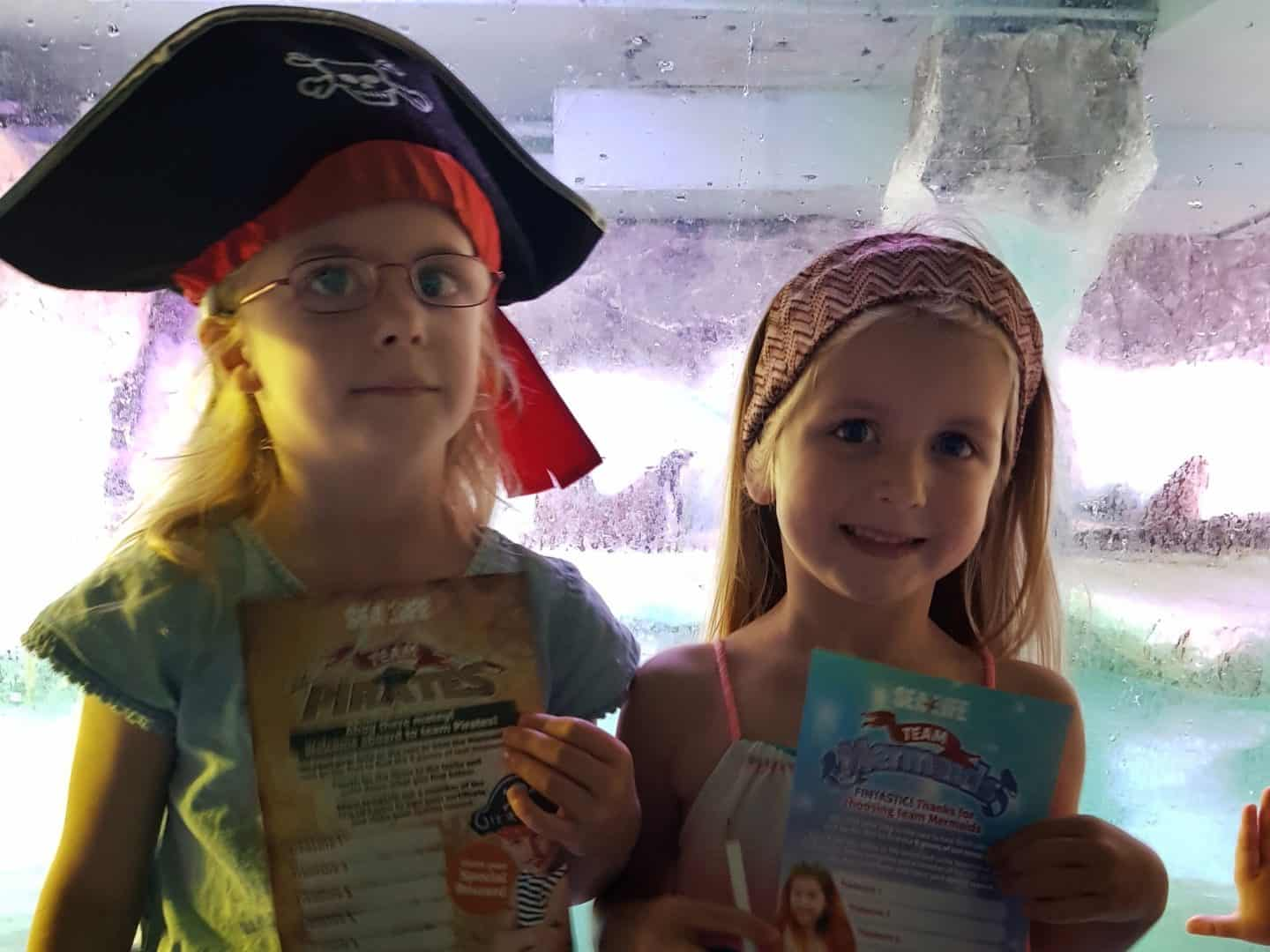 Children dressed as a pirate and mermaid at the National Sea Life Centre