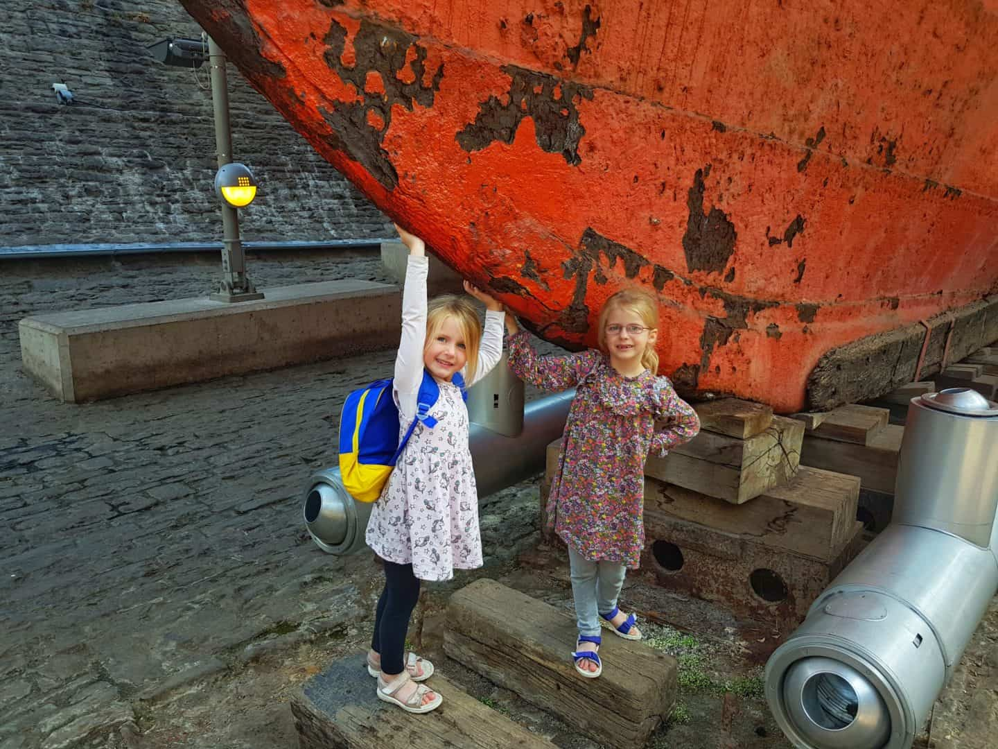 Children touching SS Great Britain in dry dock
