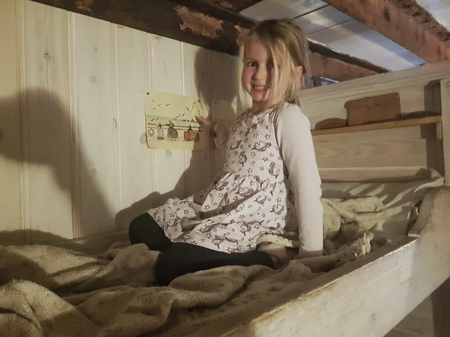 girl on top bunk of cabin bed on SS Great Britain