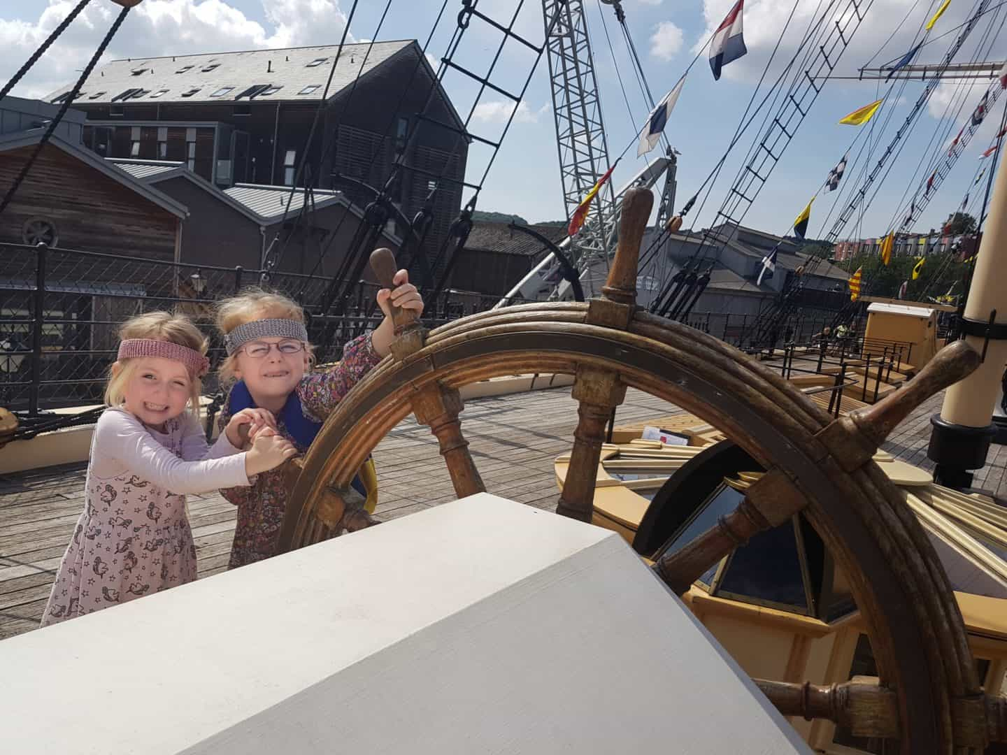 Children turning the SS Great Britain steering wheel