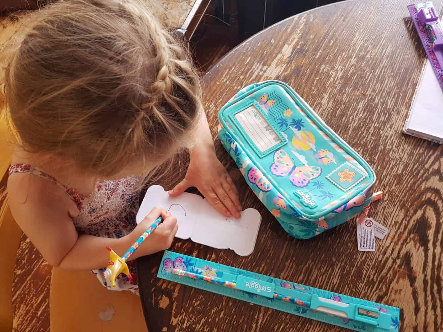 writing with Smiggle pencil and pencil case