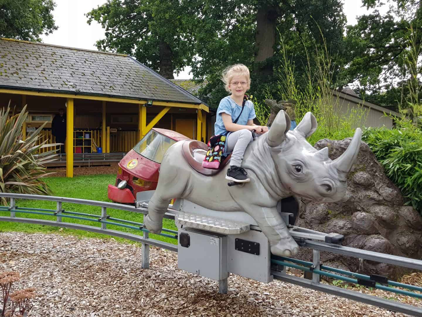 Girl on rockin' rhino ride at Longleat Safari Park