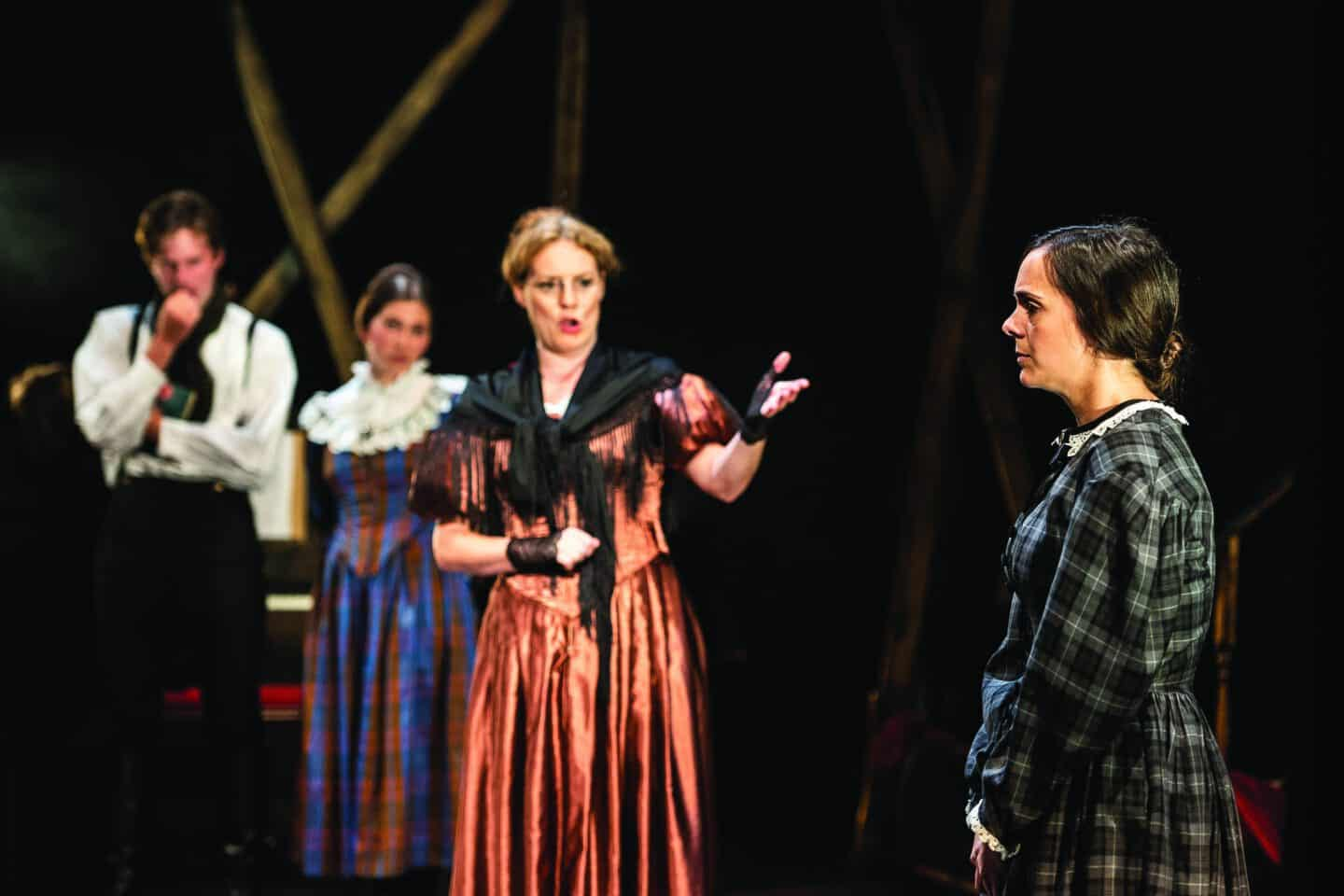 Jane Eyre on stage with another female character