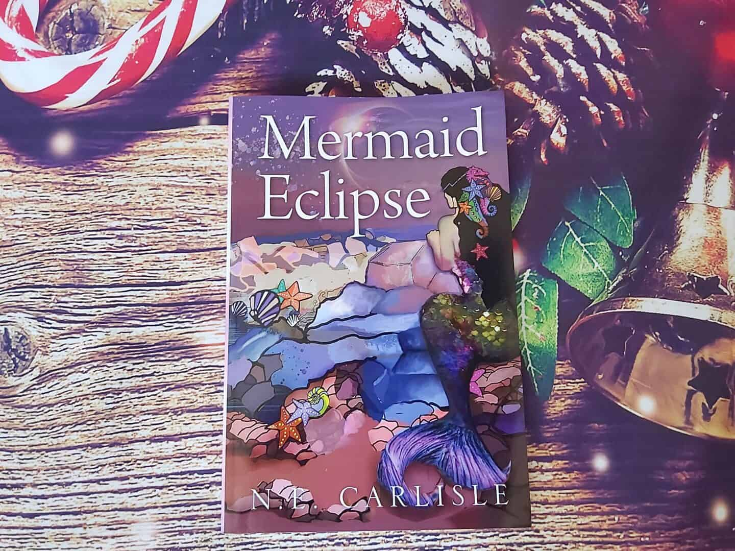 Mermaid Eclipse fiction for older children - something to read for four gift rule. Displayed against Christmas background
