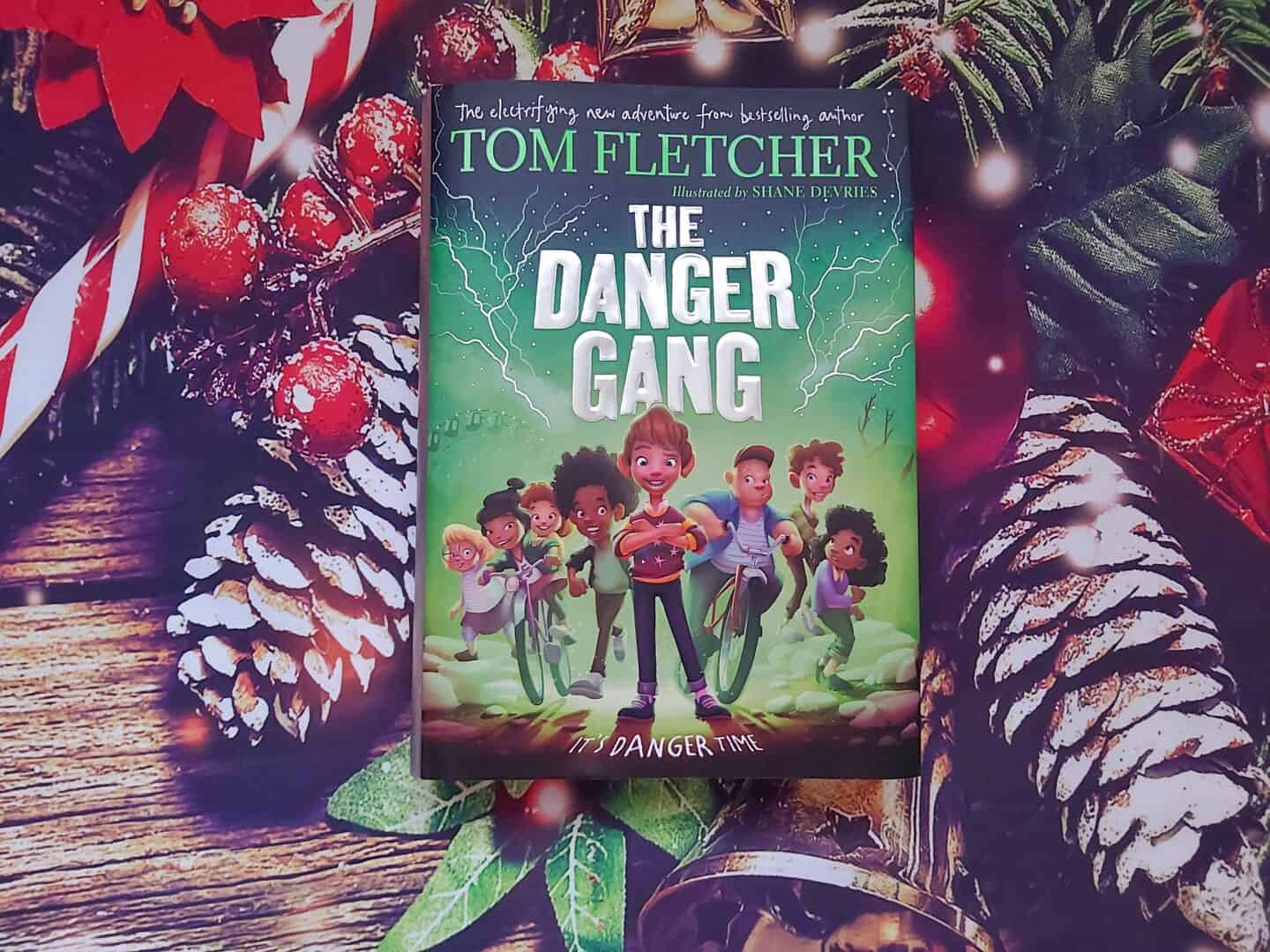 The Danger Gang by Tom Fletcher book against Christmas backdrop