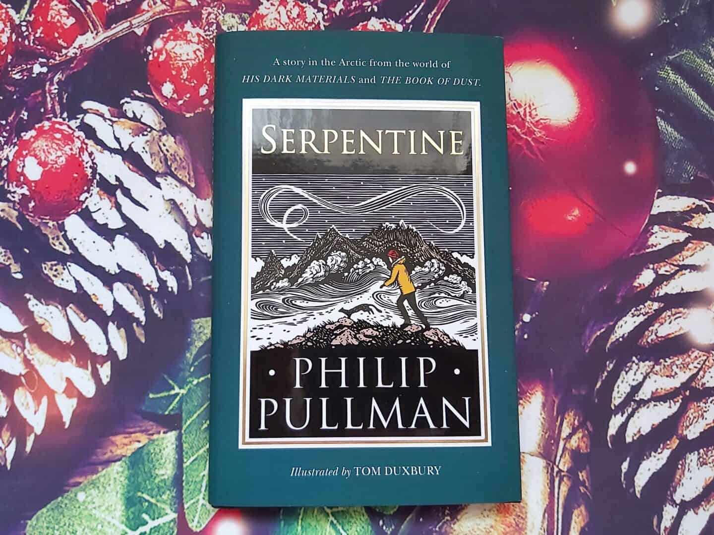 Serpentine by Phillip Pullman small book against Christmas background