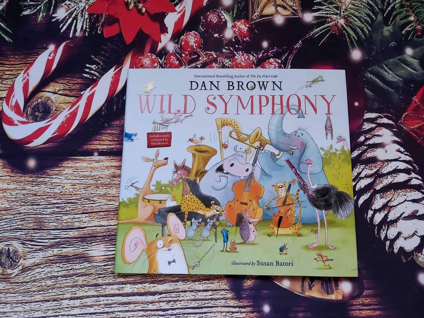 Wild Symphony children's illustrated book against Christmas background