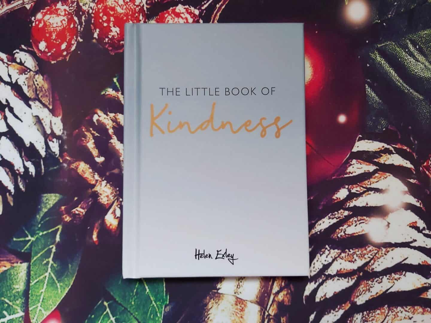 The Little Book Of Kindness by Helen Exley - small book on festive background