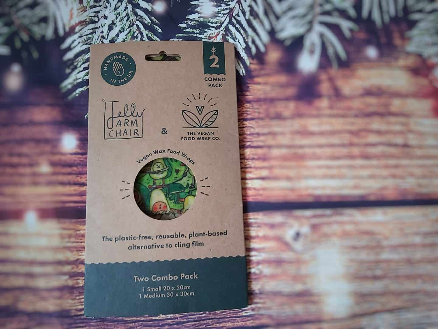 Vegan wax food wraps in recyclable cardboard packaging on festive background