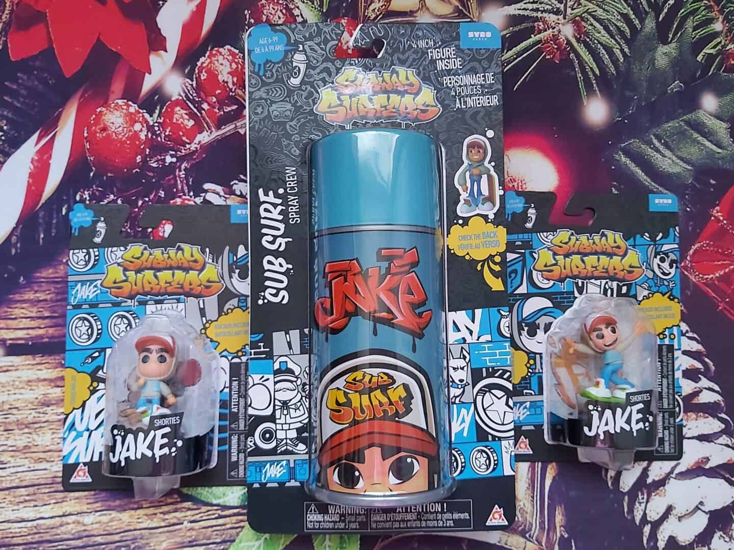 Subway Surfers spray can and vinyl figures on Christmas background