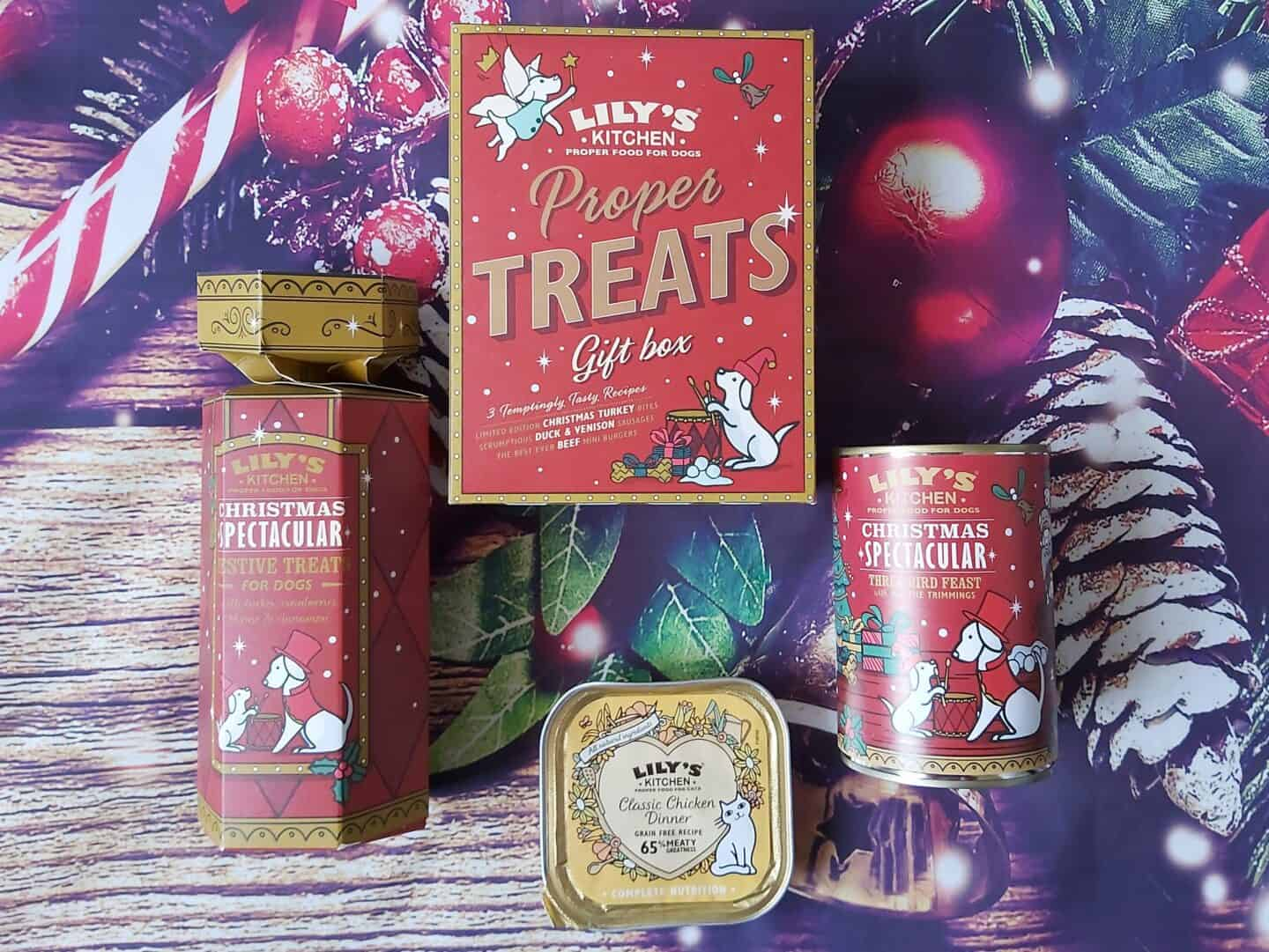 Lily's kitchen treats for dogs and cats in festive packaging against a Christmassy background