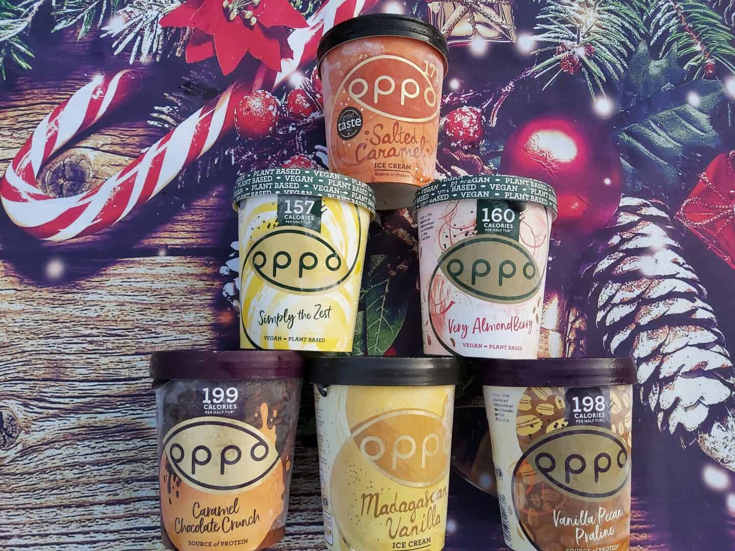 6 tubs of Oppo ice cream against a Christmassy background
