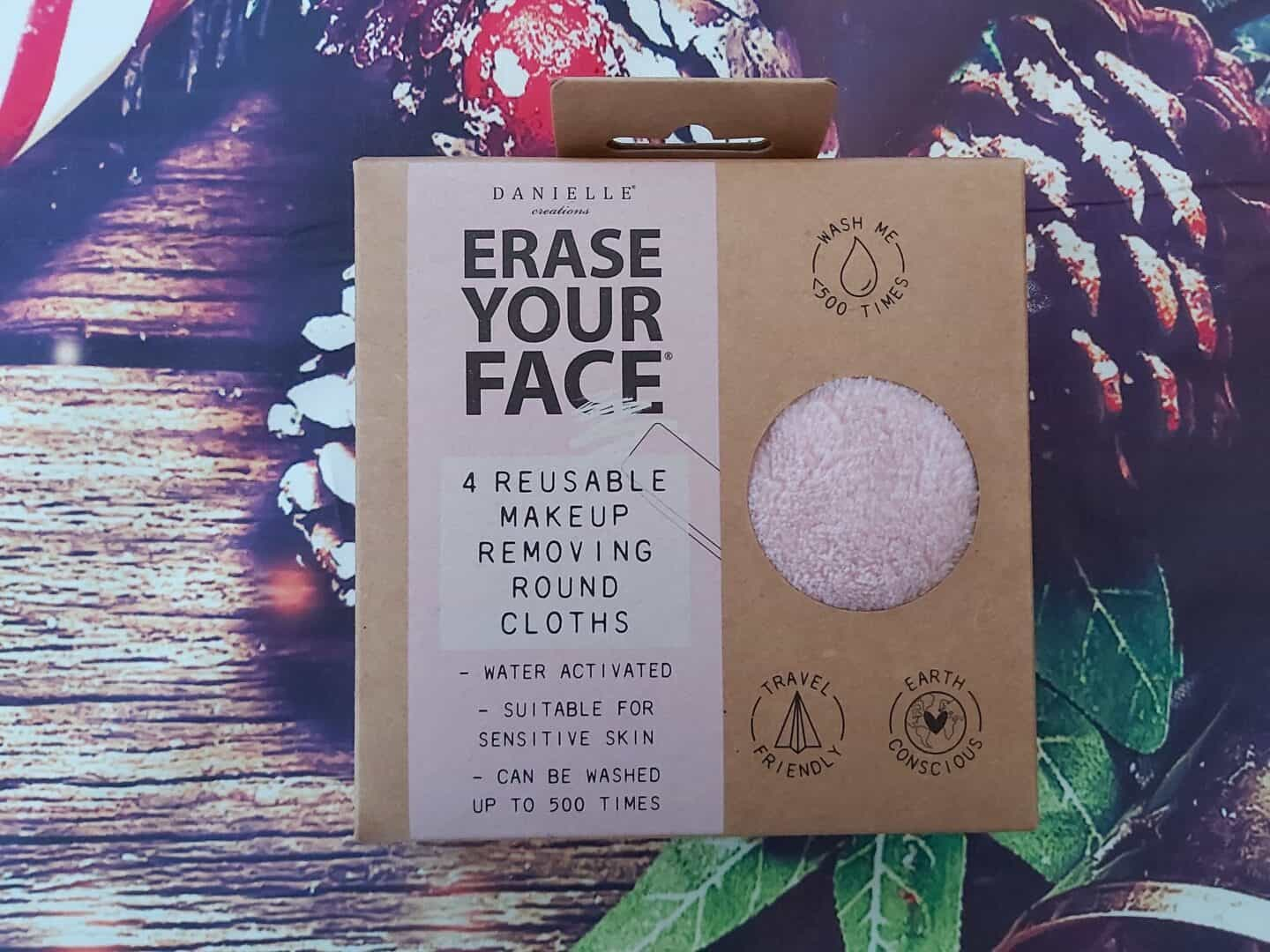 Reusable make up wipes in cardboard box on Christmas background