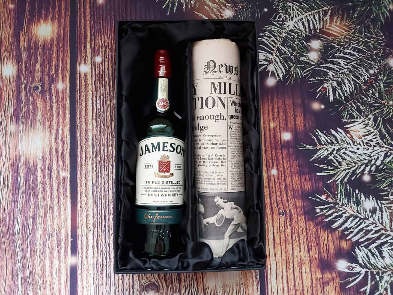 Jameson Irish Whiskey and Newspaper Gift Set on festive background