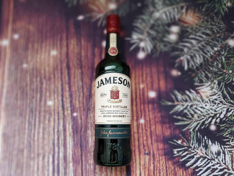 Bottle of Jameson Irish Whiskey on festive background